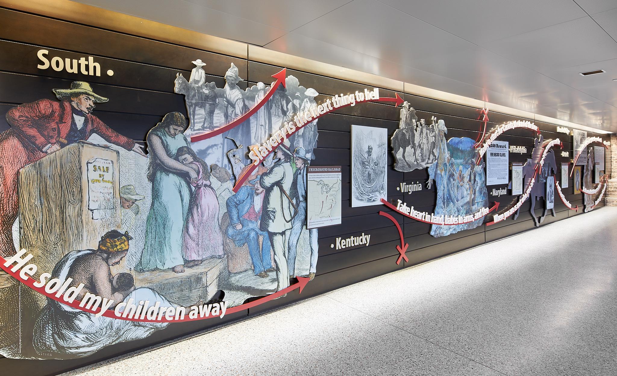 Figure 1. Underground Railroad historical overview wall and gathering area. Niagara FallsUnderground Railroad Heritage Center, Amtrak Station Atrium. Photo: Copyright 2018 Kim Smith Photo and Seth Frankel/Studio Tectonic.