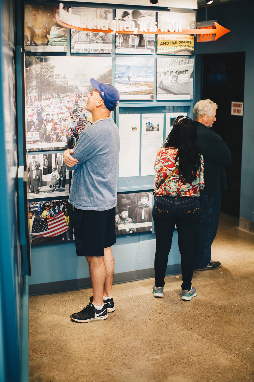 Figure 5. Museum visitors explore the photo wall in theFreedom Gallery and connect to events related to freedomfrom theCivil War era to present. Courtesy of Niagara FallsUnderground Railroad Heritage Center. Photo by AlanadetolartsPhotography.