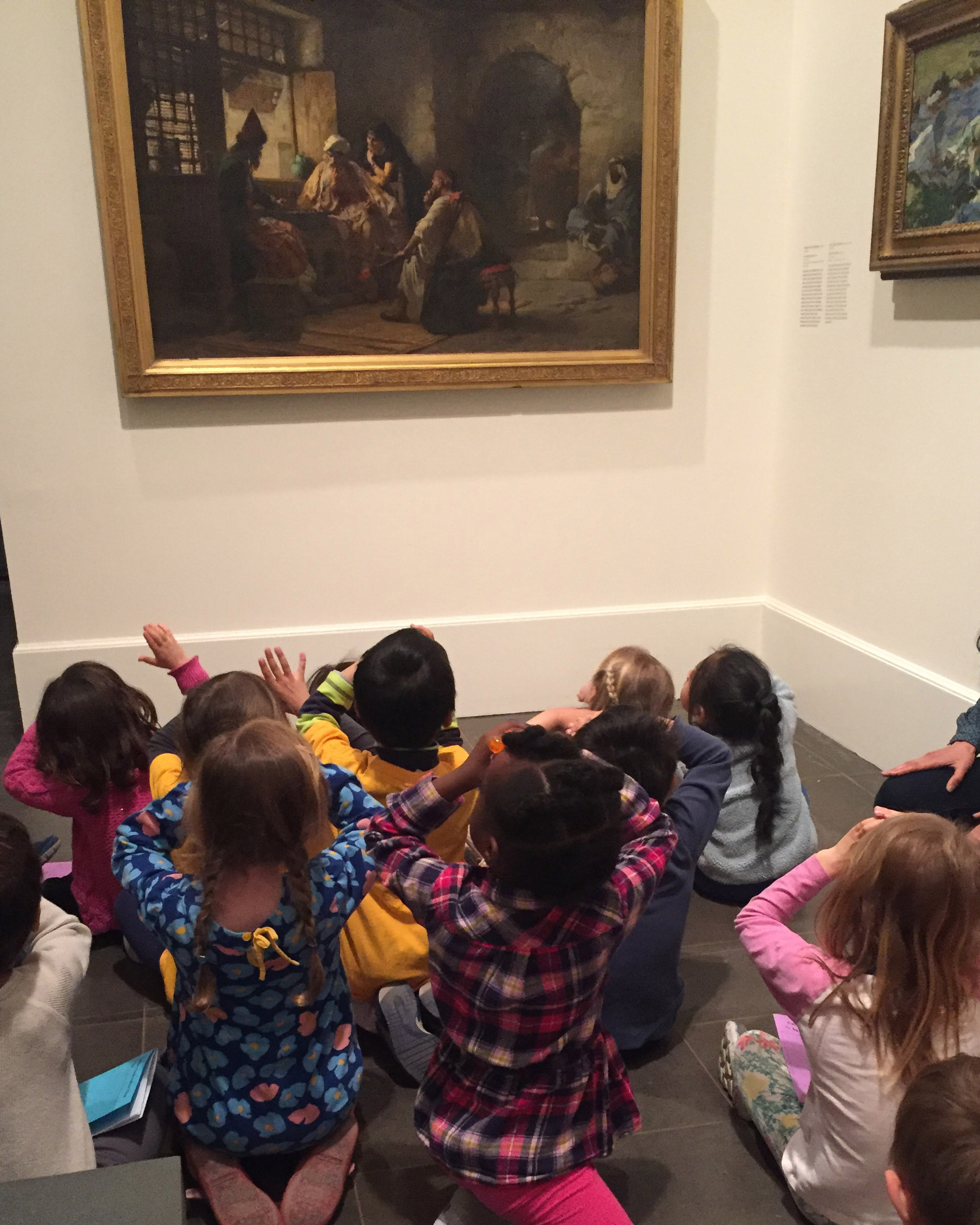 Figure 1: Kindergarten students examine an artwork at the Brooklyn Museum.