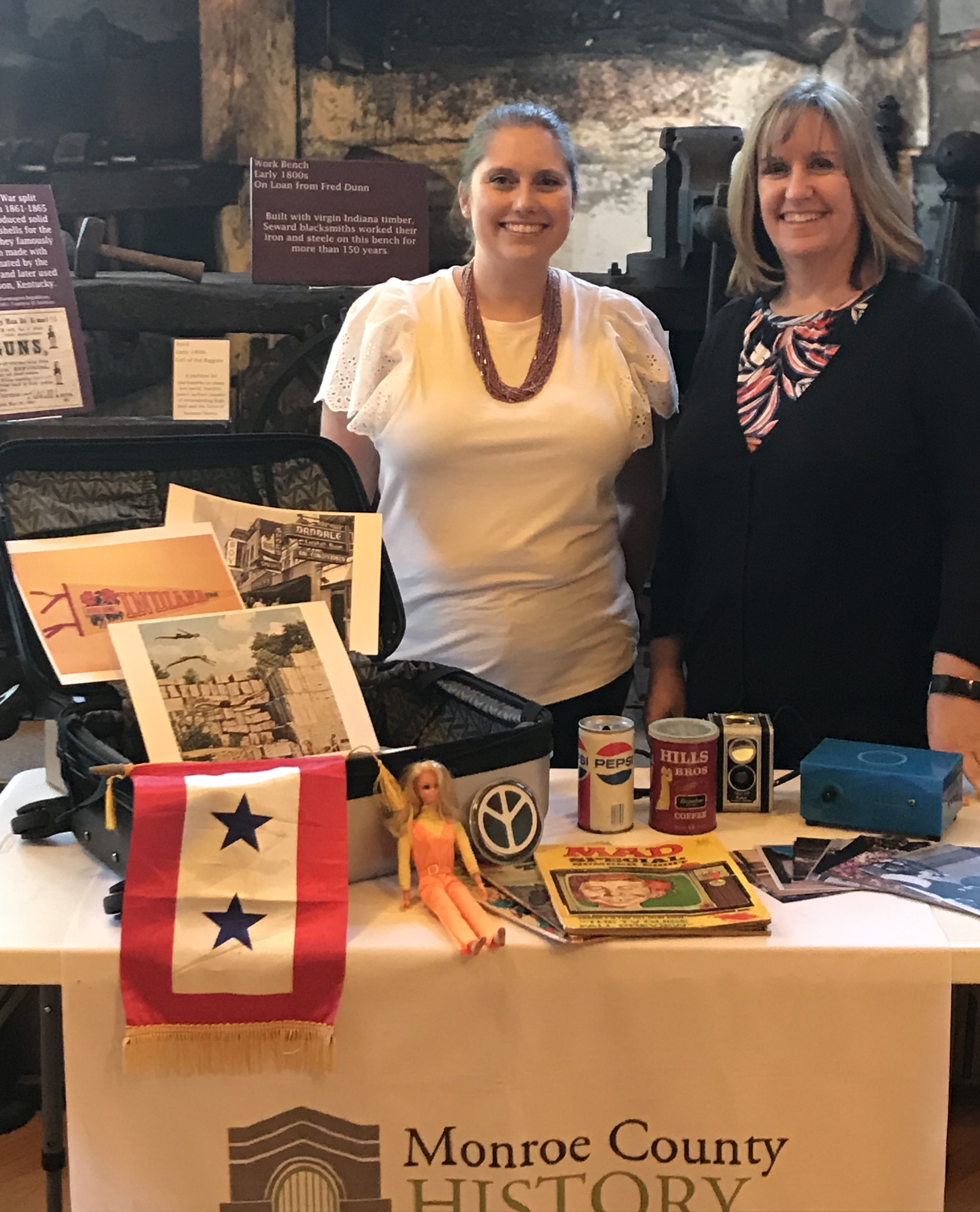 Figure 1: Hilary Fleck (left), Collection Manager,and Susan Dyar (right), Director, of the MonroeCounty History Center pose with the first memory box.